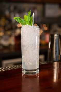 The Southside The Southside is the signature cocktail at legendary former speakeasy the 21 Club. It's also said to be the favorite drink of notorious Prohibition-era bootlegger Al Capone and his gang. 1.25 oz Tanqueray Ten 0.5 oz lime juice 0.5 oz simple syrup 2 sprigs of mint Club soda Muddle one mint sprig with lime and simple. Add Tanqueray and shake well. Pour into glass over crushed ice and stir until the outside of the glass frosts. Top with soda and garnish with sprig of mint. Photo…