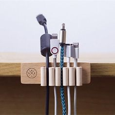 Tidy up your workspace with the Wooden Desktop Cable Organizer. No more untangling cables or any falling into the abyss behind your desk. This cable tidy has six bunched leather loops to provide the p