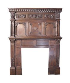 19THC. CARVED OAK FIRE SURROUND INCORPORATING EARLIER ELEMENTS - UK Architectural Heritage