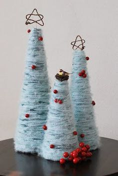 yarn tree                                                                         http://pretty-ditty.blogspot.com/2009/12/yarn-christmas-trees-tutorial.html