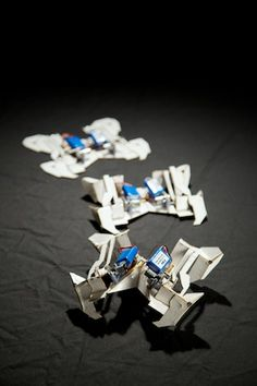 This self-folding robot goes from flat to fast (sort of) in just four minutes. Using flat materials and origami-inspired patterns, researchers have designed a real-life transformer that can assemble itself, then walk and even turn around on its own. The work was published in Science this week.  Read more at http://www.iflscience.com/technology/origami-robot-folds-itself-then-just-crawls-away#QpOB182BxepW68Fv.99