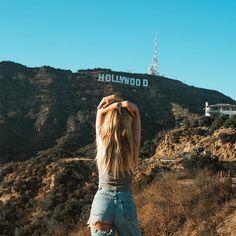 Enjoying the views. Instagram : misstomtom Hollywood Sign Los Angeles California babe highwaisted jeans model street style blogger instagram pose blond wavy hair long watch mvmt
