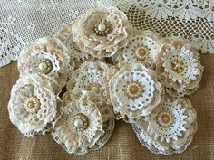 Shabby chic lace flowers are perfect for any kind of embellishing. They can be added to headbands, hair clips, brooch pins, bridal bouquets, mason jars, vases, purses, tables, pillows, and much more