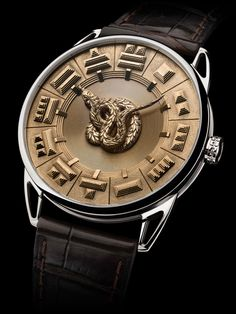 De Bethune watches Quetzalcoatl men's watch features original gold hour markers representing an aerial view of Aztec pyramids. The animated dial in solid gold contrasts with the white gold case. Fine Watches, Men's Watches, Cool Watches, Fashion Watches, Unique Watches, Amazing Watches, Beautiful Watches, Stylish Watches, Luxury Watches For Men