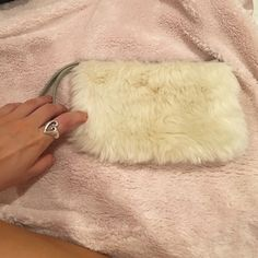 Fur wristlet Never used. Marked as FP for visibility Free People Bags