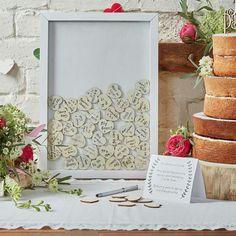 www.weddingdeco.nl   alternatief gastenboek. Set met 70 hartjes en een lijst: €26.95