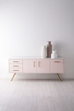 Pink cabinet with white and mauve vases