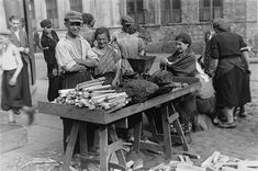 Wood and coal vendor in the streets of the Warsaw ghetto. With power only available in some parts (and not regularly) wood and coal stoves were the only means of heating and cooking.