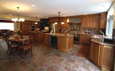 A SERIOUS kitchen featuring His cooking area and Her baking section! - Design Build Pros