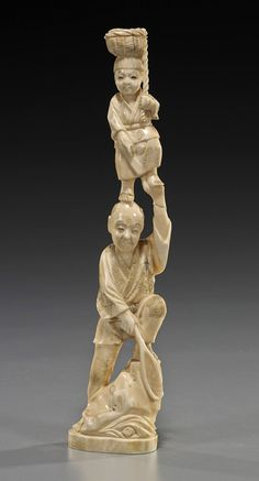 Antique Japanese Carved Ivory Figural Group of a Man Standing on a Rockery and Holding a Net and with a Boy Standing on his Head, Finely Patinated. Circa 1900 Measures 8 3/4 Inches in Height