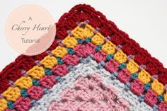 Learn how to add beautiful crochet afghan edging to your granny squares with this Granny Square Border Tutorial. This crochet edging technique is a beautiful way to finish off any granny square pattern. Add as many layers of borders as you like.