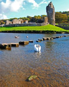 The stepping stones and Ogmore Castle, Ogmore, Bridgend, South Wales, UK