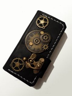 Love this one! Papyrus Crafts Handmade Steampunk Book-style Case for iPhone 5 and 5S
