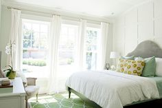 Caitlin Creer Interiors Tiek Built Homes - Fresh spring bedroom design with Surya fallon green rug, West Elm gray Scroll Headboard, Thibaut blue & green suzani fabric pillows, gray vintage Bergere chair and decorative wall panels. looks. Bedroom Retreat, Home Bedroom, Bedroom Decor, Bedroom Ideas, Master Bedrooms, Bedroom Inspiration, Bedding Decor, Coastal Bedrooms, Master Room