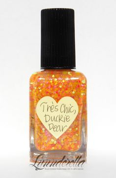 Très Chic, Duckie Dear has yellow and orange neons, orange holographic microglitter all in a clear, pink-shimmered base.