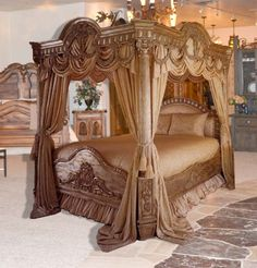 The carved work on this bed is beautiful. I have never imagined sleeping in a canopy bed like this but I think I'm in love.