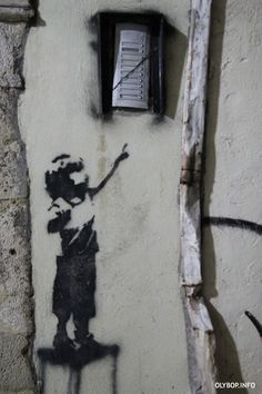 street art by Banksy. Child reaching for doorbell.  000