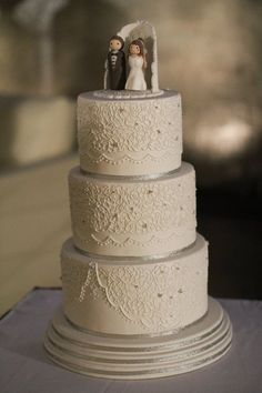 white lace wedding cake - Three tier cake covered in white fondant with hand piped royal icing lace. *please excuse the photos quality.