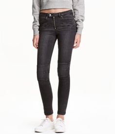 Nearly black. CONSCIOUS. Low-rise, ankle-length jeans in washed stretch denim. Pockets and decorative zips at front, back pockets, and skinny legs with zips