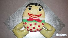 White chocolate ganache with licorice hair, red smartie dots, green and white sprinkles belt and white chocolate eyes. I made a gluten free butter cake for the body with red velvet arms and legs.