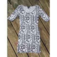 Tight fitting tribal print dress Worn once. No stains or damages. Has quarter link sleeves. Its ver cute  Rue 21 Dresses