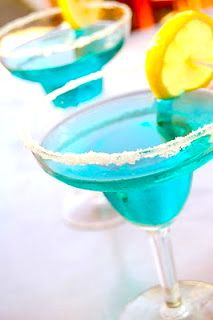 Blue ocean cocktail. Website is in French, but I know enough French to translate the recipe!  Basically 3 oz grapefruit juice, 1 ounce blue curacao and 1 ounce vodka (I would use rum).  Mmm.