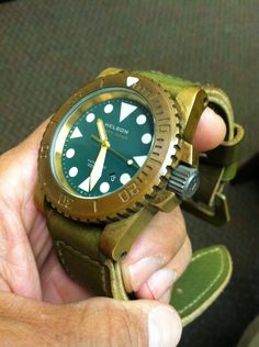 Helson Shark Diver Bronze 45mm on a Wotancraft Amazon strap.   Thanks to tridad on watchuseek. http://forums.watchuseek.com/f29/fs-helson-bronze-shark-diver-green-dial-great-patina-extras-791103.html