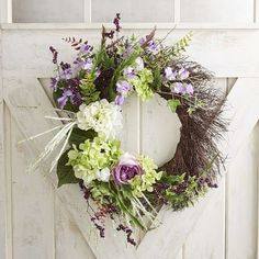 By mixing size, shape and color, our handcrafted wreath brings charm and energy to your front door. All these faux florals work in perfect harmony—lilacs, peonies, hydrangeas, sweet peas, lavender and berries. Asymmetrical, yes, but beautifully balanced, too.