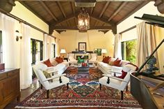 Spanish Style Homes Colonial Spanish Interior Design Ideas Living Room with Ornate Rug Wood Beams Dark Wood Furniture Warm Colored Accessories Spanish Style Interiors, Spanish Interior, Spanish Revival Home, Spanish Style Homes, Interior Design Living Room, Living Room Designs, Interior Paint, Interior Ideas, Living Rooms