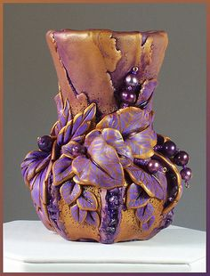 Hand-sculpted polymer clay vase with fresh-water pearls and amethyst. ~Eugena Topina