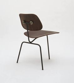 Three-Legged Side Chair  Charles Eames (American, 1907-1978)    c. 1944. Molded canaletta plywood, lacquered metal rod, rubber shockmounts, and rubber glides