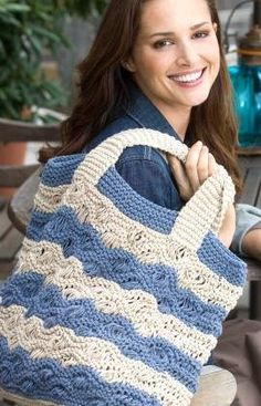 Waves Tote Bag-  Knitting a purse can be fun and practical. This beautiful Waves Tote Bag is just what you need this summer. Whether you use it to keep your coupons organized during a shopping trip, or if you just need a colorful new bag for spring, you'll love this free pattern.