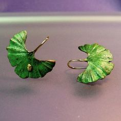 Ginkgo Leaf Earrings, Tiny 18k insect, 18k Gold Earwires, Green Patina, Made to order. $235.00, via Etsy.