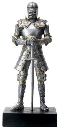 A Italian knight stands at attention in full armor with sword in this statue…