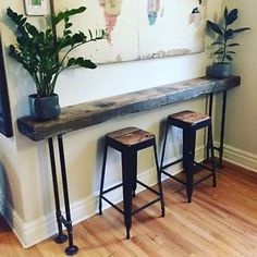 We love the rustic feel of these consoles. Old wood makes interiors warm and welcoming! #celebratedesign #rusticfurniture #wooddesign