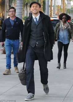 Handsome man: On Friday, Charlie Hunnam looked like he stepped off a GQ magazine cover whi...