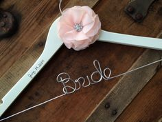 SALE Wedding Dress Hanger with Chiffon Rhinestone Flower - Blush Wedding, Bride Hanger, Personalized Name Hanger, Custom Bride Gift by DeighanDesign on Etsy https://www.etsy.com/listing/175424906/sale-wedding-dress-hanger-with-chiffon