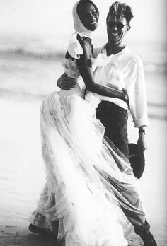 """nightswimming: """" Iman (dress by Karl Lagerfeld for Chanel Haute Couture) and David Bowie on the beach at Cape Point Nature Reserve near Cape Town, South Africa. Photographed by Bruce Weber, Vogue,. Bruce Weber, Happy Together, Ansel Adams, Dona Summer, Iman And David Bowie, Iman Bowie, Karl Otto, Gisele Bündchen, Vogue Wedding"""