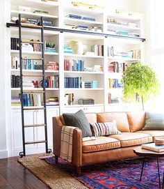 Spotlight on Layered Rugs Design Trend! Tons of design inspiration & examples of how to use layered rugs in any room in your home to add texture and style. Diy Interior, Living Room Interior, Living Room Decor, Living Room Bookcase, Living Rooms, Modern Interior, Interior Decorating, Built In Shelves Living Room, Interior Livingroom