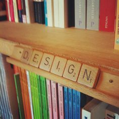 Making labels for your book shelves out of scrabble letters. Awesome idea!