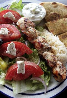The souvlaki plate at Vasili's is loaded with meat, a fresh salad, tzatziki and pita. Click through to read the restaurant review. (Shmuel Thaler/Sentinel)