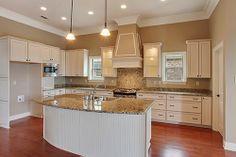 Kitchen with a Custom Hood 460 N. Corniche du Lac, Maison du Lac - Ron Lee Homes