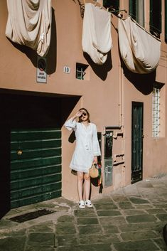 Zara white cut out lace mini dress, gucci ace heart embroidered sneakers, straw bag, ray ban round sunglasses, italy, couturezilla, andreea birsan, cute summer and fall outfit ideas 2017, white mini dress, cutout white dress, how to wear a dress with sneakers, sneakers trend 2017, statement sneakers, white kicks, white leather sneakers, statement striped black and red eyelet shoulder bag, cavalli bag, gucci sneakers, how to look Parisian chic, European summer street style inspiration for…