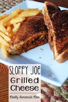 Sloppy Joe Grilled Cheese - Homemade skillet sloppy joes sandwiched between gooey cheddar grilled cheese - a total family favorite!