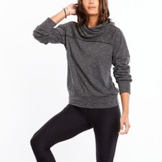 A key player in your winter workout wardrobe, this pullover has a cowl and banded bottom to keep in the warmth.