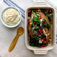 Deliciously creamy cashew nut cheese spread on a baked sweet potato with sautéed spinach, pomegranates and quinoa. Gluten free, vegan.