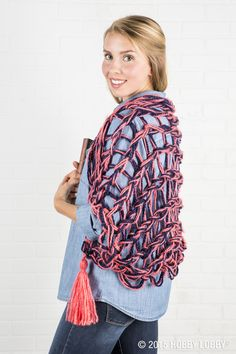 No need for knitting needles! This colorful shawl can be made using your arms instead.