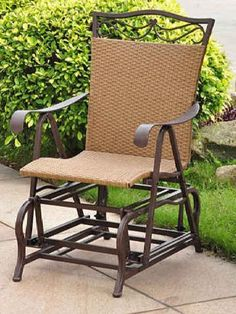 """VALENCIA RESIN WICKER and STEEL PATIO/PORCH GLIDER - PATIO FURNITURE by International Caravan. $188.95. This chair bench has a smooth gliding motion. The metal frame of this chair gives it a strong quality. Size: 41""""H x 26""""W x 34""""D. Made from weather proof materials. Color: Matte Brown. For over 44 years, International Caravan has been one of the leaders in quality outdoor and indoor furniture. Using only the finest materials, they bring skill, craftsmanship, ..."""