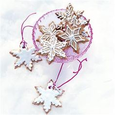 Snowflake biscuits recipe. These beautiful iced biscuits look lovely hung on the Christmas tree, which makes them an ideal home-made gift. These will keep in an airtight tin for 3 weeks.