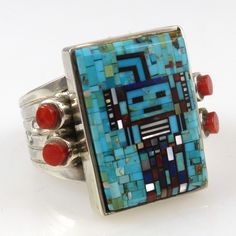 Irene and Carl Clark, Sterling Silver Ring with a Micro-Inlaid Yei (Navajo Healing Spirit) Design using Turquoise, Coral, Lapis, and Mother of Pearl and set with Mediterranean Coral